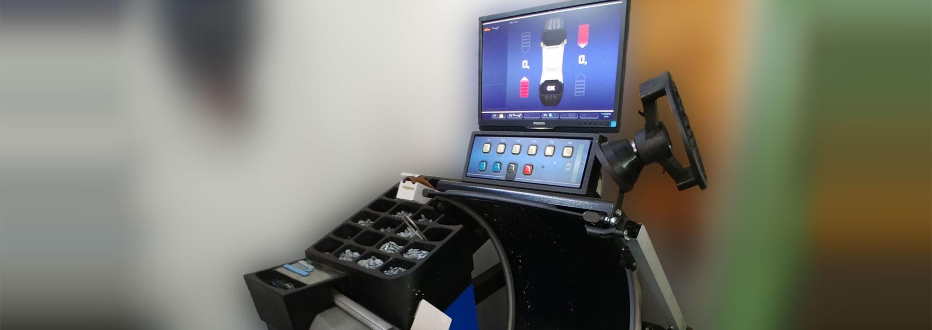 Service Reifenmontage - Bild Wuchtmaschine